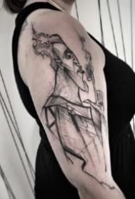 帅气的大臂位置的散点纹身图案